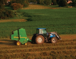 "Baling with the ""blue"" tractor"
