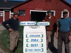 Anthony Graham, Lincoln Geiger, and Andrew Kennedy at the public entrance to the farm.